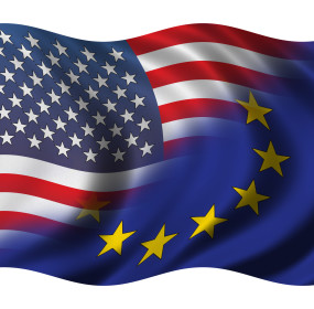 Half american - Half european flag waving in the wind - clipping path included