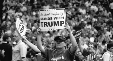 """Trump supporters holding a sign that reads """"The Silent majority stands with Trump"""""""